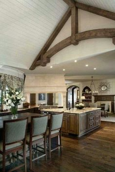 Great style of Beams but be real...take out the white ceiling there