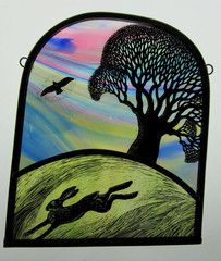 Hand-crafted stained glass panel of a leaping hare at dawn by Tamsin Abbott http://www.shop.obsidianart.co.uk/collections/mad-march-hares/products/tamsin-abbott-dawn-hare-tree-buzzard
