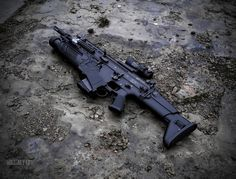 SCAR-H. However, this is in black, which suggests civilian, but with an FN EGLM grenade launcher, which strikes me as not legal for civilians. Maybe this is Airsoft? Military Weapons, Military Life, Fn Scar, Battle Rifle, Fire Powers, Tumblr, Assault Rifle, Fantasy Weapons, Guns And Ammo