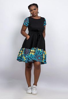 With its shift shape and high neck, the Ekan is a dress that suits a variety of heights and shapes. Frill detailing to the hem sets it apart from other designs. Short African Dresses, Latest African Fashion Dresses, African Print Dresses, African Print Fashion, Africa Fashion, Ankara Fashion, African Prints, African Fabric, Short Dresses