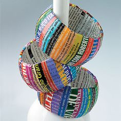 Recycled Magazine Bangle [Gives me ideas to use with my clients!] - pinned by Private Practice from the Inside Out at http://www.AllThingsPrivatePractice.com