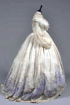 One-piece gown, circa 1860s, with band of purple grasses at the hem and overall sprigged design. Via Kerry Taylor Auctions.