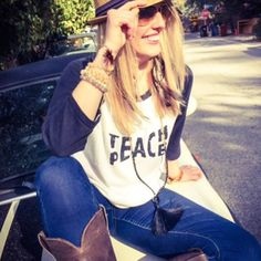 "Epic @jeanneve, living the dream today in our ""Teach Peace"" baseball tee! ❥"