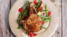 Baked pork chops with green beans, potatoes, and roasted red peppers