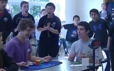 Other Rubik's Cube enthusiasts dash over to see what has happened as people begin to cheer