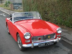 1965 MG Midget Oh how I would have loved to have this car whe I was younger! My mother worked at the MG car factory in London as a secretary when she was a young girl.