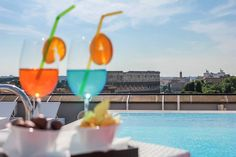 Just #relax with a cocktail in one hand, a book in another, and a beautiful view... @ Mercure Roma Centro Colosseo #Italy