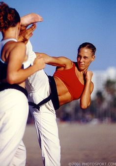 Women in martial arts kicking butt! Martial arts is the best workout and self defense tool ever!!