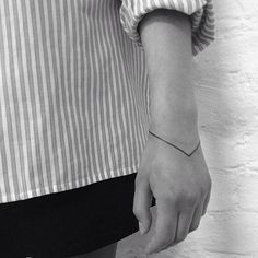 really cool idea to have just a simple bracelet tattoo.