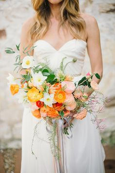 orange poppy bouquet - photo by Delbarr Moradi http://ruffledblog.com/romantic-vow-renewal-after-10-years