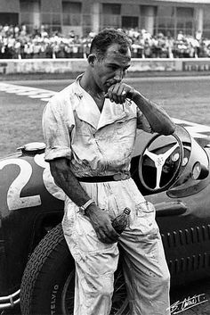 Stirling Moss, 1954 Italian GP at Monza. Stirling Moss, tired and disillusioned, parked his Maserati 250F in the pit straight with a blown engine ten laps before the end of the 1954 Italian GP in Monza. Photographer Bernard Cahier was there, and handed a bottle of Coke to his friend Moss before taking this iconic photo with his Leica. In a seven-year span between 1955 and 1961, Moss finished as championship runner-up four times and third the other three.