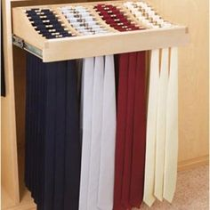 Tie rack holds over 120 ties on full-extension slides with rubber o-rings to prevent slipping.