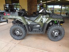 2014 Polaris®  A14TN5EAA - Sportsman® X2 550 EPS Sage Green with a optional added seat. 800 lbs. Suspension. With fog light, 2500 lbs tension wench, upgraded tires, second seat, and rifle scabbard it is $13,050.00 brand new