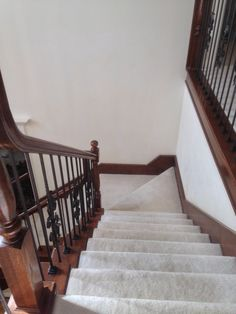 Venetian Stairs did a full baluster upgrade at the Law residence. The existing wooden pickets were carefully measured, then replaced with our PC28/3 and PC44/1 wrought iron balusters. Shoes were added to the bottom of the posts to complete the old world look.