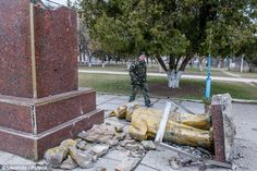 Monument: A statue of Lenin lies toppled and smashed by vandals in the Crimean city of Zuya