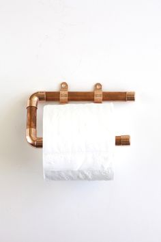 Copper Pipe Toilet Paper Holder. Or any other metal  paint it into your favourite color. Mine is glossy black with heavy duty bolts.