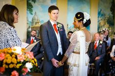 Bride and groom exchanging vows at their Braxted Park wedding ceremony