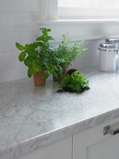 Update your kitchen for less with a classy laminate countertop paired with white subway tile backsplash.