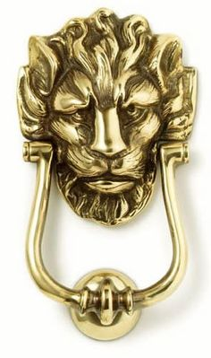Solid brass, elegant, and authentic is the replica of the original 18th century lion doorknocker fastened to the discrete black door of the residence of the British Prime Minister at 10 Downing Street