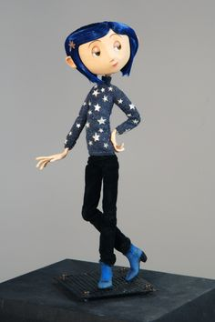 Coraline in star sweater - was actually knitted by a miniature knitted who lives in Minnesota.  She is the only woman in the world that does this.