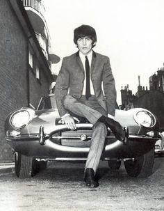 George Harrison sitting on his E-type Jaguar after a minor car accident at New King's Road/ Munster Road, London.