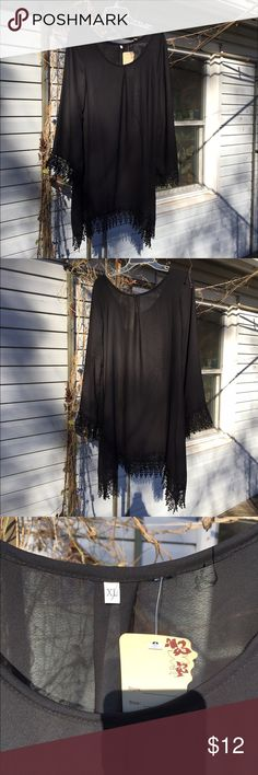 Cover-up, sheer black Cover-up, sheer black. Great for wearing over swimsuits, bodysuits or evening a pretty black bra with slacks, a skirt or shorts even! Size 12. Asking $12. Tops Blouses