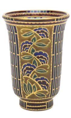 A French Enameled Glass Vase, Auguste Heiligenstein, circa 1920, of tapering footed form, decorated with alternating panels depicting a nude maiden or flowers, signed Aug. Heiligenstein, numbered 152.
