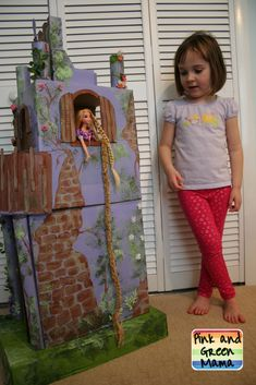 """Pink and Green Mama: Cardboard Rapunzel Castle: Homemade """"Tangled"""" Tower. LOVE this idea! What a cute party decoration that the birthday girl gets to play with after the party."""