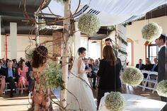 Traditional Tallit Chuppah with Hanging Flower Pomanders from The Showplace Floral & Event Design - mazelmoments.com