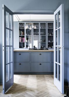 Rustic kitchen with modern touches.  Periwinkle cabinets, walls, and door casings envelope the space in soothing, calm color. floor, paint palettes, color, duck egg blue, cabinet, blue kitchens, design kitchen, blues, kitchen designs