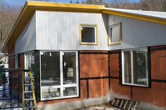 metal siding for houses | the corrugated metal siding is going on this week our house is going ...