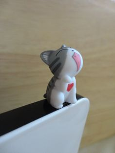 Cute Gray Cat with Heart sittng Dust Plug - earphone plug. $5.00, via Etsy.