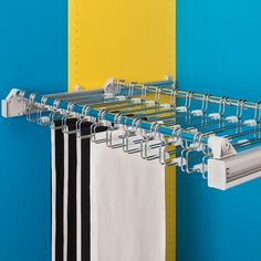 A convenient option particularly suitable for hanging trousers. Adjustable from 750mm to 1150mm, this unit also partially extends on a pull out frame for great accessibility. Available with either steel supports (as shown here) or plastic supports, the Ambos Adjustable Trouser Rack has 12 loops and holds 24 pairs of trousers.