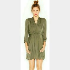 FLASH✨HPx4✨ BAR lll 3/4 sleeve surplice neck dress Color is olive green. (1st, 3rd and 4th pic actual color) dress features surplice neckline, pullover style, 3/4 length sleeves with elastic cuffs, elastic waistband that ties at back, welt pockets at side hips, a line silhouette, lined. Wore 1 time and dry cleaned once. In excellent conditon. 100% polyester. Bar III Dresses