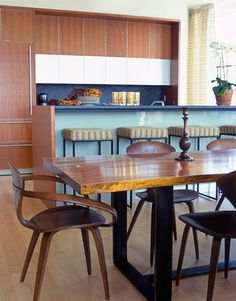 Warm + modern, blue + brown: Norman Cherner chairs + beautiful maple dining table by xJavierx, via Flickr