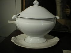 Archive Photo: White Ironestone Covered Soup Tureen with Platter. Applied Gourd finial and raised leaves on the lid. Circa: 1855-1858.  As seen in the pantry of the Old Kitchen in Atwood House. Gift of Estelle Martelle, from George Bearse Home, next to Queen Anne Inn. Tureen ID: 1985.1051.002, Lid ID: 1985.1051.001 and Platter ID: 1985.1051.003. #tureen, #kitchen, #pantry, #atwoodhouse, #chathamhistoricalsociety, #capecod