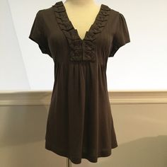 """Banana Republic Pleated V-Neck Top This top from Banana Republic has such a cool """"origami"""" detail around the neck in a gorgeous chocolate brown color. It's a soft blend of cotton and modal with a flattering empire waist. In excellent condition with no rips, stains or holes. Worn once or twice. Please ask questions before purchase as all sales are final. Banana Republic Tops Tunics"""