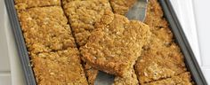 Try our flapjack recipe, a really easy tray bake. Oaty flapjacks can be served up with a cup of tea or packed into lunch boxes for an energy hit Tray Bake Recipes, Sheet Cake Recipes, Gourmet Recipes, Sweet Recipes, Baking Recipes, Sheet Cakes, Potato Recipes, Yummy Recipes, Easy Flapjacks