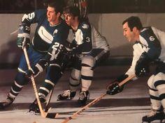 Selwood and Ellis of the Leafs vs. Kurtenbach of the Canucks.