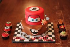 Convert to Monster Truck? Cars inspired cake with matching cuppies by Andrea's SweetCakes, via Flickr