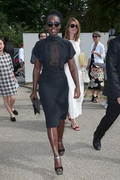 Lupita Nyong'o stuns in a fitted black sheer panel dress at Maison Margiela.