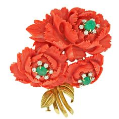 Brooch | David Webb. 18k gold, diamonds, emeralds and antique oriental carved coral. c. 1960s
