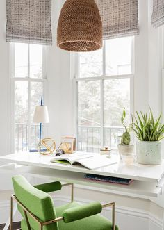 A basket light pendants hangs above a white modern desk seating a green desk cha… – Home Office Design Vintage Home Office Space, Home Office Desks, Small Office, Office Workspace, Window Desk, Window View, Window Seats, Bay Window Living Room, Green Desk