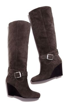 Knee-high boots with a stacked wedge, ankle wrapped detail with buckle