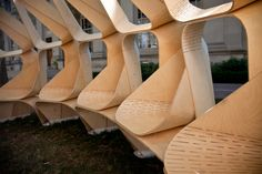 If you find yourself in the streets of Boston and wondering around MIT you may come across the Kerf Pavilion by Brian Hoffer, Christopher Mackey, Tyler Crain, and Dave Miranowski. The pavilion is . Wood Architecture, Architecture Details, Parametric Architecture, Living Hinge, Portable Shelter, Curved Wood, Digital Fabrication, Parametric Design, Dynamic Design