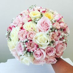 A pink bridal bouquet using roses