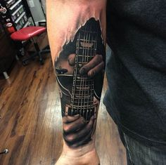 A music lovers dream..... by Kyle Cotterman. #inked #inkedmag #tattoo #guitar #rock #roll #realism #hands