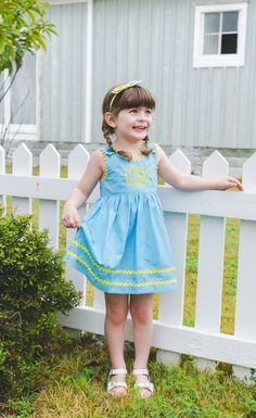 This blue gingham dress is ready for summer days full of backyard parties!