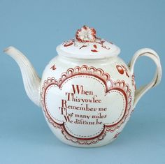 Leeds Creamware teapot & cover. (c. 1780 England) 1/2    Leeds creamware teapot & cover with twisted strap handle and moulded spout. Decorated in red enamel with a a panel containing the inscription ' When This you see Remember me Tho' many miles We distant be', the reverse painted with scattered floral sprays