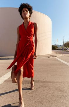 At once effortless and elegant, this asymmetrical wrap dress is styled from richly textured crepe with draping that elevates this simple design to special-event status.
